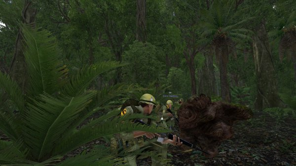 Doc, Handberg, and Tank crouch near a log as a strange fish smell wafts the jungle